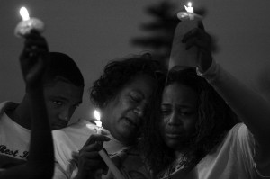 Baltimore family lights candles for dead teen's brithday